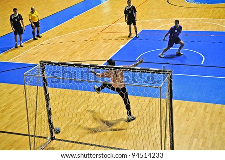 TURIN - FEBRUARY 4: Handball match in Serie B between Città Giardino Torino Vs Derthona. Unidentified player shot a penalty. February 4, 2012 Turin, Italy.