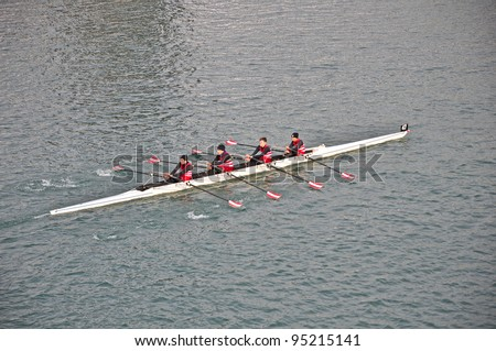 "TURIN - FEBRUARY 12: River Po, an unidentified crew during the traditional International long distance rowing regatta ""D'inverno sul Po"" on February 12, 2012 Turin, Italy. - stock photo"