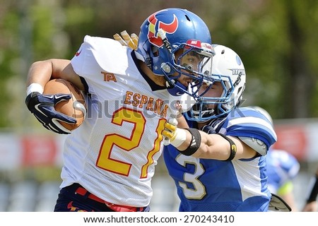 TURIN, ITALY - APRIL 12, 2015: CANET MORENO Camil (left) is stopped by PANATO Edoardo (right) during Italy vs Spain U19 american football match, in the Nebiolo Stadium in Turin. - stock photo