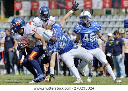 TURIN, ITALY - APRIL 12, 2015: CANET MORENO Camil (left) passes RIGAMONTI Gaetano (center) and VENTURA Riccardo (right) during match with Italy vs Spain U19, in the Nebiolo Stadium in Turin. - stock photo