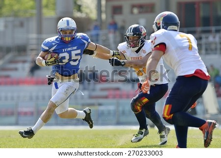 TURIN, ITALY - APRIL 12, 2015: CUOMO Valerio (left) run with ball. Italian U19 team win the qualifying match with Spain for European championship, in the Nebiolo Stadium in Turin.