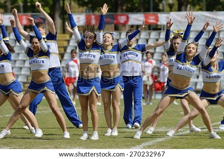 TURIN, ITALY - APRIL 12, 2015: Italian cheerleaders of Rainbow team exhibit during match interval of qualifying match Italy vs Spain for European championship, in the Nebiolo Stadium in Turin.
