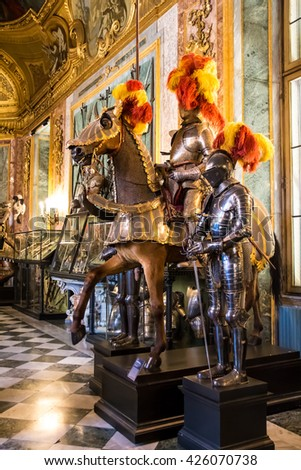 TURIN, ITALY - APRIL 25, 2016 -   Medieval knights on horses, in the Royal Armoury of Turin, one of the world's most important collections of arms and armour, located in the Royal Palace.