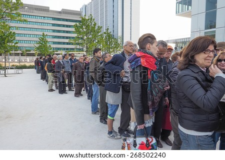 TURIN, ITALY - APRIL 11, 2015: People queueing to visit the new Intesa San Paolo skyscraper designed by Renzo Piano Building Workshop which just opened today and is the highest building in Turin - stock photo