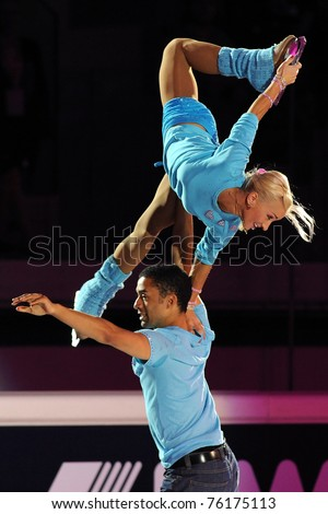 TURIN, ITALY - APRIL 09: Professional German skaters Aliona SAVCHENKO & Robin SZOLKOWY perform gala during the 2011 Gran gala del Ghiaccio on April 09, 2011 in Turin, Italy. - stock photo