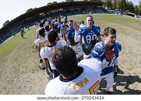 TURIN, ITALY - APRIL 12, 2015: TURIN, ITALY - APRIL 12, 2015: America football national team of Italy cheers after match vs Spain U19, in the Nebiolo Stadium in Turin. - stock photo