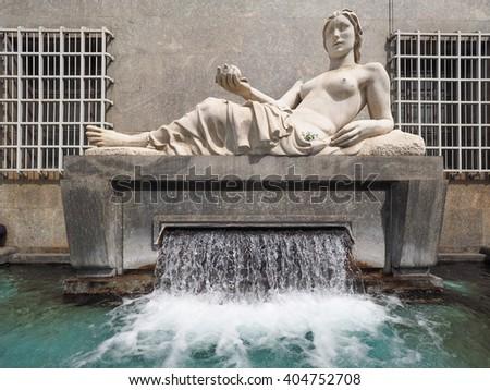 TURIN, ITALY - CIRCA APRIL 2016: Fountain and Statue symbolising river Dora - stock photo
