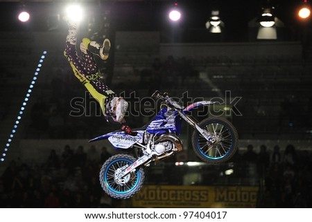 TURIN, ITALY - FEB 03: Clinton Moore (AUS) performs trick during the 2012 FIM Mx Freestyle World Championship on February 03, 2012 in Turin, Italy.