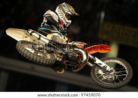 TURIN, ITALY - FEB 03: Hannes Ackermann (GER) performs trick during the 2012 FIM Mx Freestyle World Championship on February 03, 2012 in Turin, Italy. - stock photo