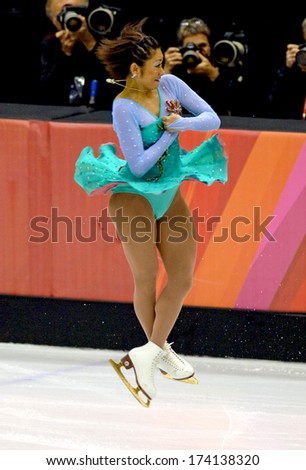 TURIN, ITALY - FEBRUARY 24, 2006: Ando Miki (Japan) performs during the Winter Olympics female's final of the Figure Ice Skating.