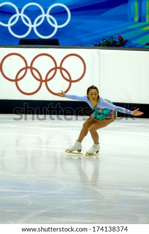 TURIN, ITALY - FEBRUARY 24, 2006: Ando Miki (Japan) performs during the Winter Olympics female's final of the Figure Ice Skating. - stock photo
