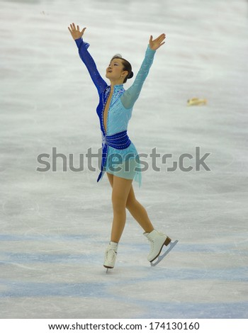 TURIN, ITALY- February 24, 2006: Arakawa Shizuka (Japan) competing during the Winter Olympics female Finale of Ice Figure Skating. - stock photo