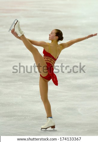 TURIN, ITALY - FEBRUARY 26, 2006: Kimmie Meissner (USA) performs during the Winter Olympics female's final of the Figure Ice Skating.