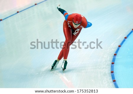 TURIN, ITALY-FEBRUARY 20, 2006: Norvegian athlete competes on the Speed Ice Skating competition during the Winter Olympic Games of Turin 2006.