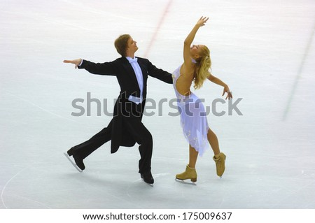 TURIN, ITALY-FEBRUARY 18, 2006: Tatiana Navka and Roman Kostomarov competing during the Couple Ice Figure Skating during the Winter Olympic Games of Turin 2006.