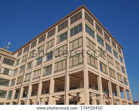 TURIN, ITALY - JANUARY 24, 2014: The Fiat Lingotto car factory designed by Trucco in 1916 was the largest car factory at the time and still houses the Fiat directional centre and an exhibition complex