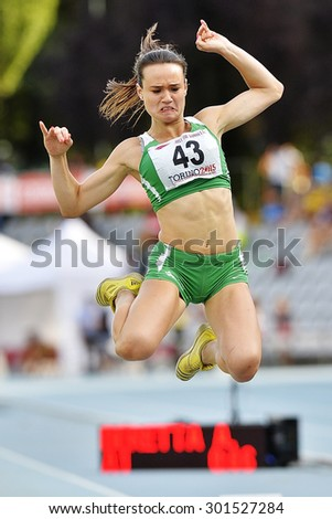 TURIN, ITALY - JULY 26: BERETTA Alessia perform triple jump during Turin 2015 Italian Athletics Championships at the Primo Nebiolo Stadium on July 26, 2015 in Turin, Italy - stock photo