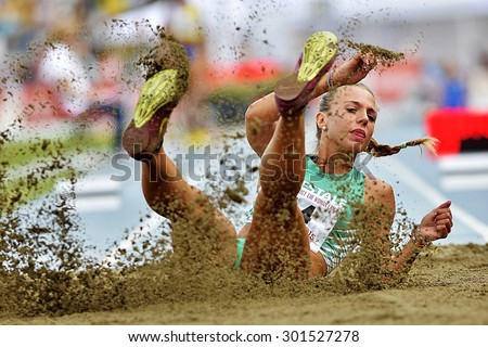 TURIN, ITALY - JULY 26: CESTONARO Ottavia perform triple jump during Turin 2015 Italian Athletics Championships at the Primo Nebiolo Stadium on July 26, 2015 in Turin, Italy - stock photo