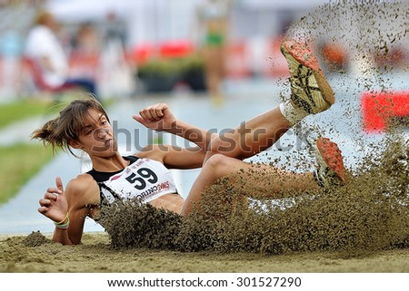 TURIN, ITALY - JULY 26: PRINA Alessandra perform triple jump during Turin 2015 Italian Athletics Championships at the Primo Nebiolo Stadium on July 26, 2015 in Turin, Italy - stock photo