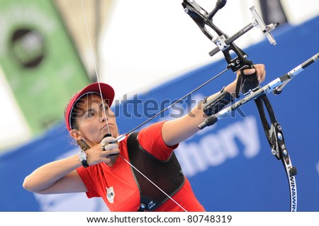 TURIN, ITALY-JULY 10: VAN LAMOEN Denisse (CHI), 2011 women recurve world champion, competes at 2011 World Archery and Para Archery Championships , on June 10, 2011 in Turin, Italy. - stock photo