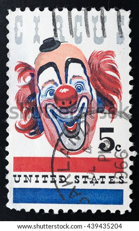 TURIN, ITALY - JUNE 19, 2016: A stamp printed in USA showing the funny face of a circus clown, circa 1966