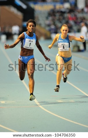 TURIN, ITALY - JUNE 08: Alloh Audrey ITA (1) Paoletta Jessica ITA (4) finish 100m sprint race during the International Track & Field meeting Memorial Nebiolo 2012 on June 08, 2012 in Turin, Italy. - stock photo