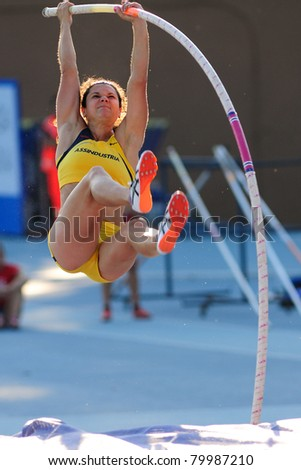 TURIN, ITALY - JUNE 26: Anna Giordano Bruno, the  2011 Italian pole vault champion, jumps at women's pole vault during the 2011 Summer Track and Field Italian Championship meeting on June 26, 2011 in Turin, Italy. - stock photo