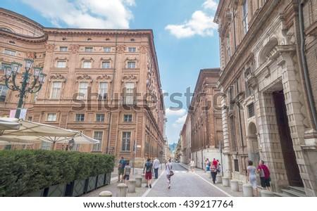 TURIN, ITALY - JUNE 28, 2015. Buildings architecture on the via Accademia delle Scienze Street with Palazzo Carignano, historical building in the centre of Turin, Piedmont, Italy. - stock photo