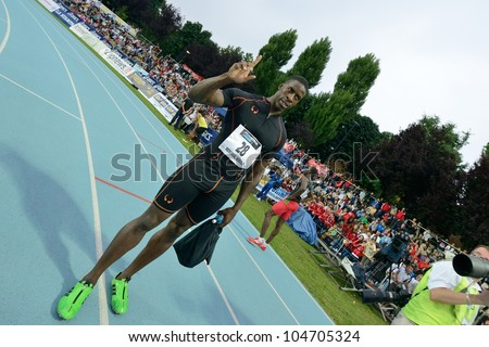 TURIN, ITALY - JUNE 08: Dwight Chambers GBR cheers after winning 100m sprint race during the International Track & Field meeting Memorial Nebiolo 2012 on June 08, 2012 in Turin, Italy. - stock photo