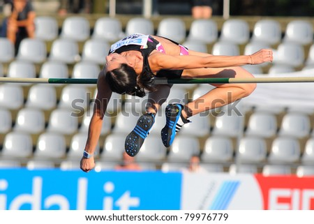 TURIN, ITALY - JUNE 25: Elena Meuti performs a high jump during the 2011 Summer Track and Field Italian Championship meeting on June 25, 2011 in Turin, Italy. - stock photo