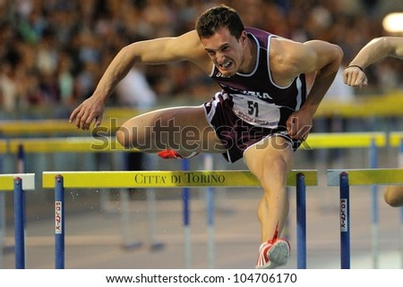 TURIN, ITALY - JUNE 08: Emanuele Abate ITA run 110m HS during the International Track & Field meeting Memorial Nebiolo 2012 on June 08, 2012 in Turin, Italy. - stock photo
