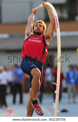 TURIN, ITALY - JUNE 25: FUSIANI Simone jumps at men's pole vault during the 2011 Summer Track and Field Italian Championship meeting on June 25, 2011 in Turin, Italy. - stock photo