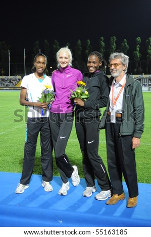 TURIN, ITALY - JUNE 12: Gordeyeva RUS (1st) Spencer LCA (2nd) Howard Lowe USA (3rd) stand high jump podium of 2010 Memorial Primo Nebiolo track and field meeting, on June 12, 2010 in Turin, Italy. - stock photo