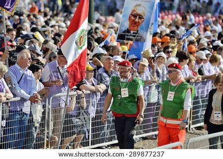 TURIN, ITALY - JUNE 21, 2015: Holy Father Pope Francesco Bergoglio visit Turin for the holy Shroud exhibition and the city cheers him with a joyful crowd in Vittorio Place. Volunteers at work.
