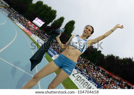 TURIN, ITALY - JUNE 08: Martina Amidei ITA cheers after winning 100m sprint race during the International Track & Field meeting Memorial Nebiolo 2012 on June 08, 2012 in Turin, Italy. - stock photo