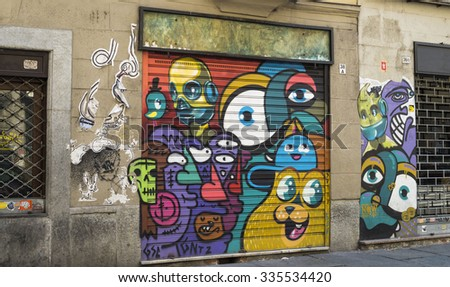 TURIN, ITALY - JUNE 28, 2015. Street art with graffiti on the wall.