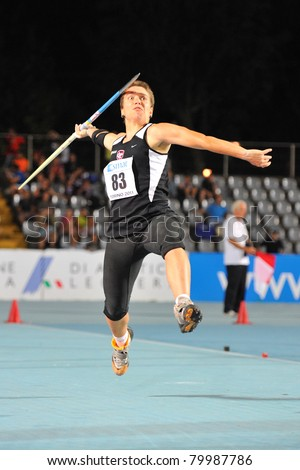 TURIN, ITALY - JUNE 26: Veronica Seimonte throws a javelin during the 2011 Summer Track and Field Italian Championship meeting on June 26, 2011 in Turin, Italy. - stock photo