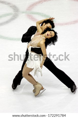 TURIN, ITALY - MARCH 29: Couple dancing during Figure Ice Skating competition of the  Winter Olympic Games in Turin, March 29, 2006.  - stock photo