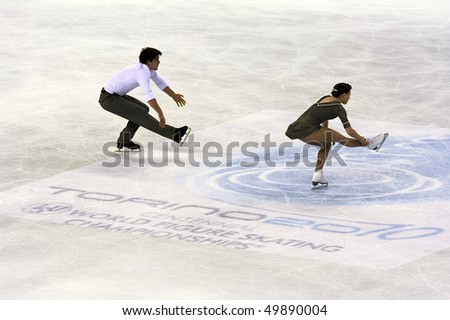 TURIN, ITALY - MARCH 24: Professional  Canadian skaters Jessica DUBE and Bryce DAVISON perform pairs free skating during the 2010 World Figure Skating Championship on March 24, 2010 in Turin, Italy. - stock photo