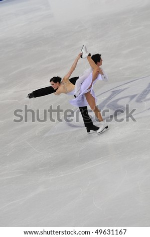 TURIN, ITALY - MARCH 26: Professional Canadian skaters Tessa VIRTUE & Scott MOIR perform free dance during the 2010 World Figure Skating Championship on March 26, 2010 in Turin, Italy.