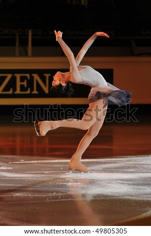 TURIN, ITALY - MARCH 28: Professional skater Yu-Na KIM from South Korea  performs short program during the 2010 World Figure Skating Championship on March 28, 2010 in Turin, Italy. - stock photo