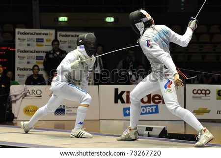 TURIN, ITALY - MARCH 13: Valentina VEZZALI (ITA) fight against Aida SHANAEVA (RUS) during team tournament final match of the 2011 Women world fencing cup on March 13, 2011 in Turin, Italy
