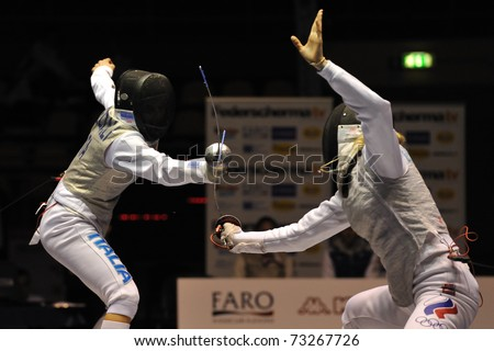 TURIN, ITALY - MARCH 13: Valentina VEZZALI (ITA) fight against Inna DERIGLAZOVA (RUS) during team tournament final match of the 2011 Women world fencing cup on March 13, 2011 in Turin, Italy - stock photo