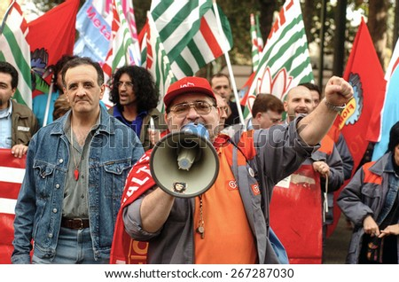 TURIN, ITALY-OCTOBER 11, 2005: Fiat metalworkers protesting on the streets during a national strike, in Turin. - stock photo