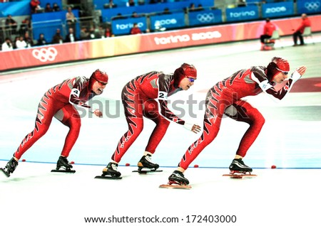 TURIN, ITALY - SEPTEMBER 29: Female speed skater team skating during the Ice Speed Skating competition of the Winter Olympic Games in Turin, March 29, 2006.