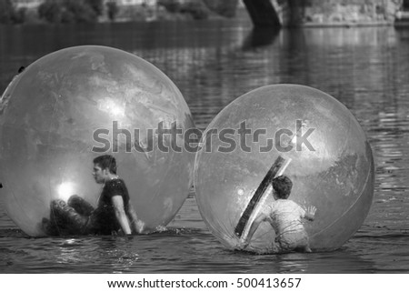 Turin, Italy - September 18, 2016:  kids zorb inside large balls on water