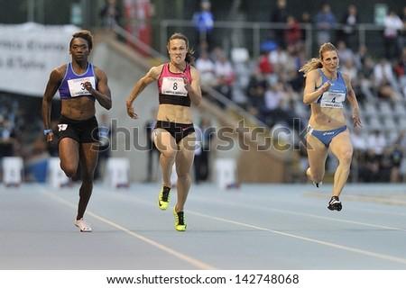 TURIN - JUNE 8:(from left) Bayne Chauntae, Povh Olesya, Draisci Ilenia runs 100m sprint women race at XIX Turin International Track and Field meeting, Italy on 8th june 2013, in Turin, Italy. - stock photo