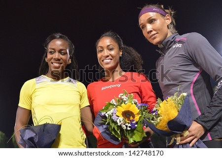 TURIN - JUNE 8: (from left) Porter Tiffany, Harrison Queen, Lolo Jones stands at 110m hurdles woman race podium at XIX International Track and Field meeting, Italy on 8th june 2013, in Turin, Italy. - stock photo