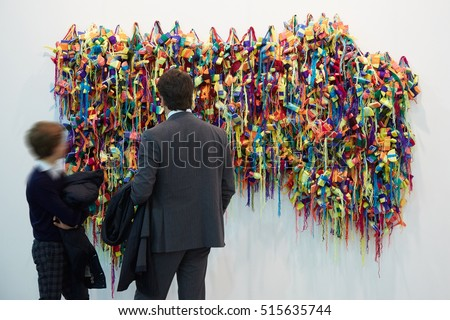 TURIN - NOVEMBER 3: Man and boy near colorful sculpture during Artissima, contemporary art fair opening on November 3, 2016 in Turin, Italy.