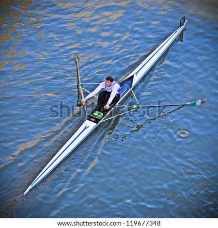TURIN - NOVEMBER 11: Rower, Verita Corrado (Italy), of De Bastiani team, during the traditional International long distance rowing regatta �Silverskiff� on November 11, 2012 Turin, Italy. - stock photo